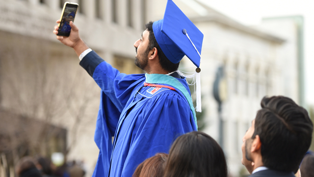 Graduate taking a selfie