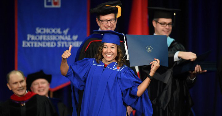 Fall landing page photo showing graduate on stage