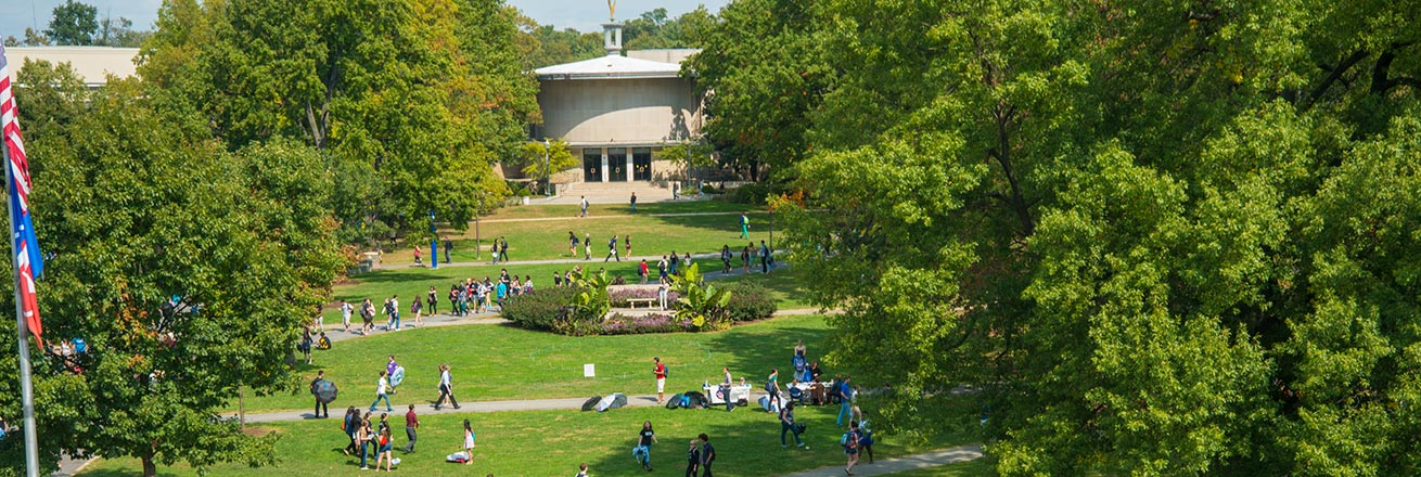 Students on the quad in summer, with the Kay Spiritual Life Center in the background
