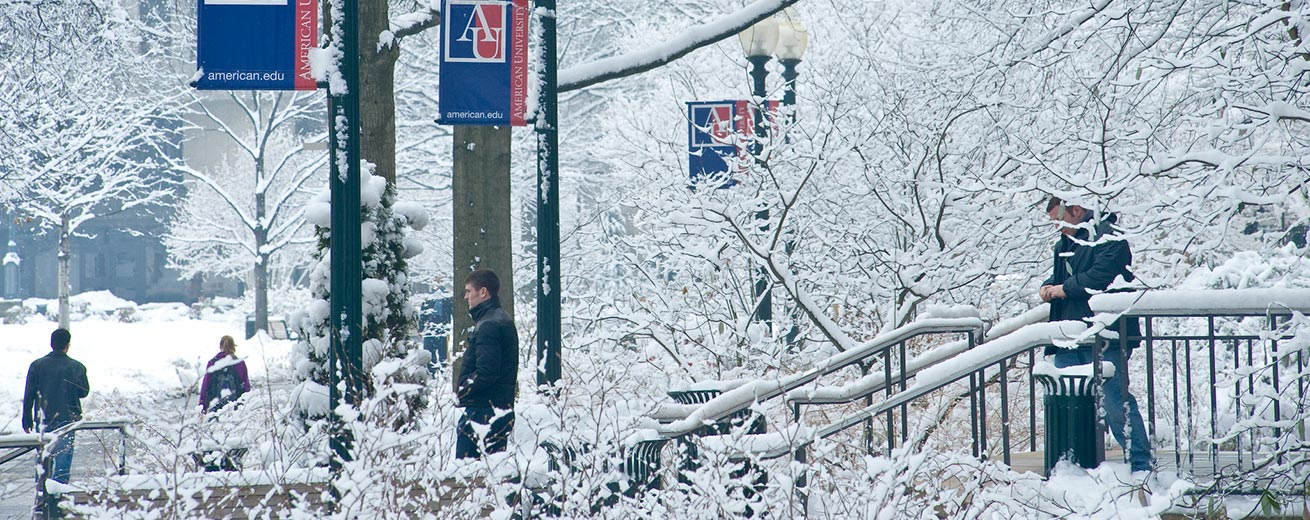 Students walk around Kogod and the quad in snow