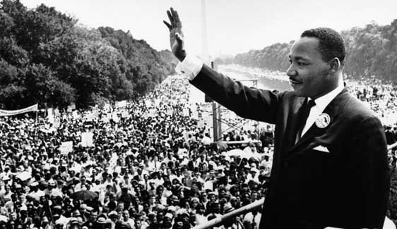 Dr. Martin Luther King, Jr., waving to people at the March on Washington for Jobs and Freedom