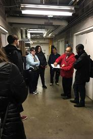 An Energy and Engineering staff member shows students the energy efficiency measures in the Katzen mechanical room