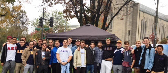 American University fraternity students in Tenleytown for neighborhood cleanup