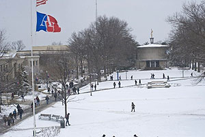 Students walking on a snow covered quad