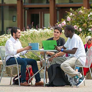Students meet on the plaza at the Leadership in Energy and Environmental Design (LEED) certified School of International Service.