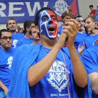 American University Blue Crew member cheers on the men's basketball team.