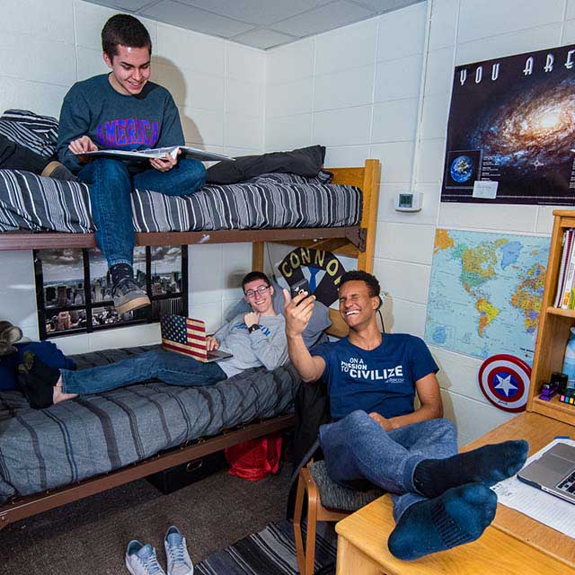 Students relax in their room in Letts Hall.