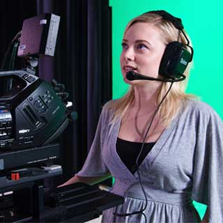 A student operates a camera in American University's state-of-the art Media Production Center.