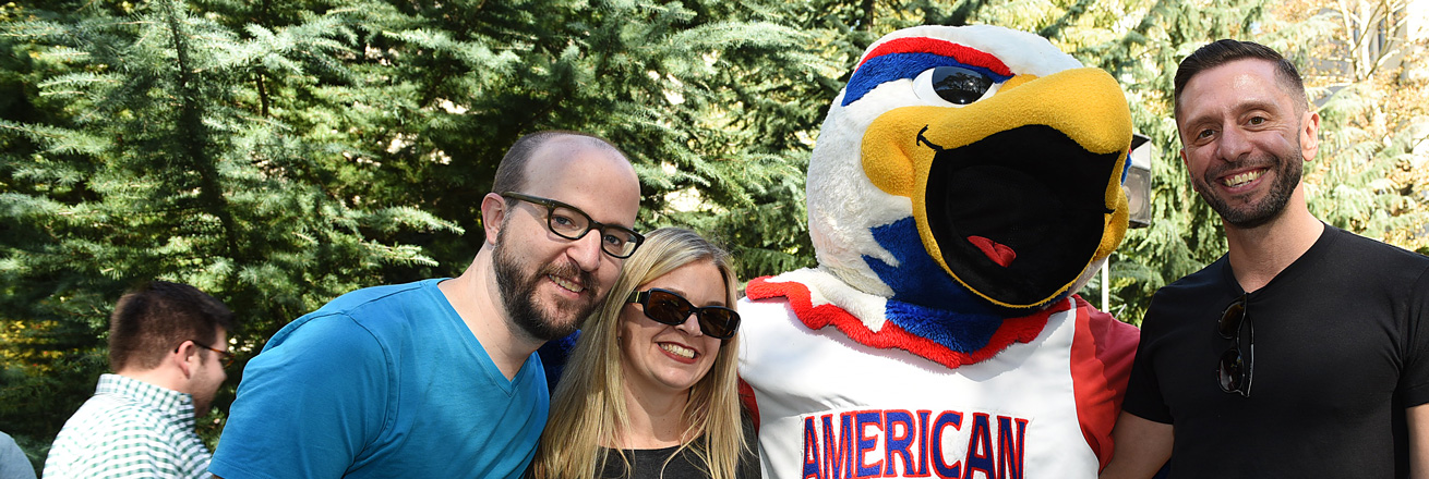 Alumni pose with AU mascot Clawed at All-American Weekend