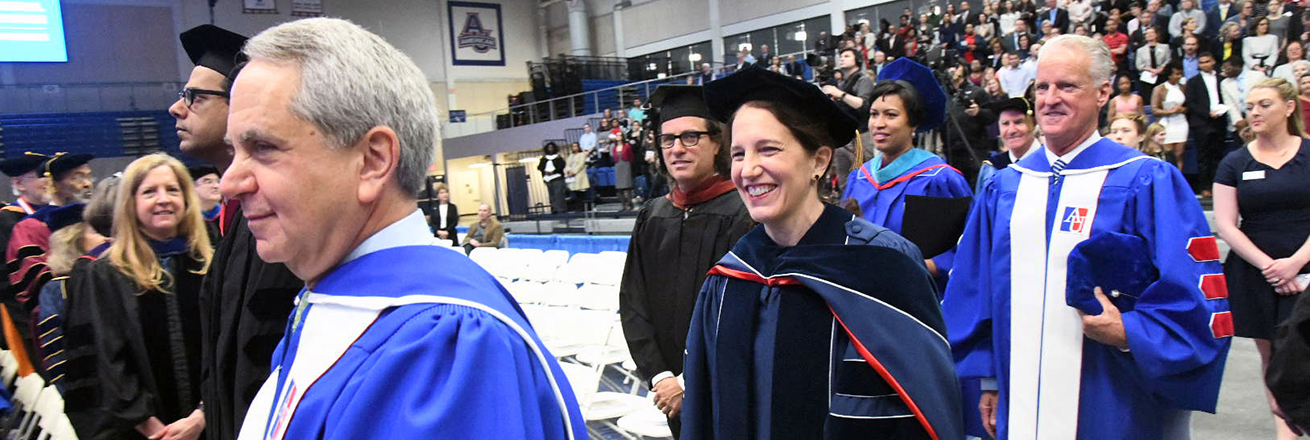 Sylvia Burwell and others enter Bender Arena for Inauguration