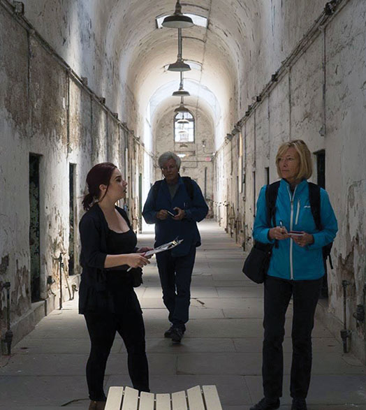 Maggie Stogner and two others tour an old prison