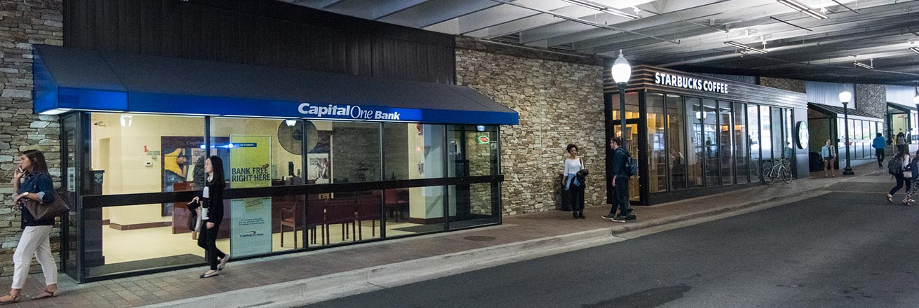Students in front of Capital One bank and Starbucks, in the Bender Tunnel