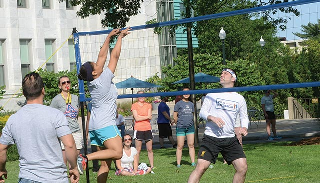 Staff playing volleyball