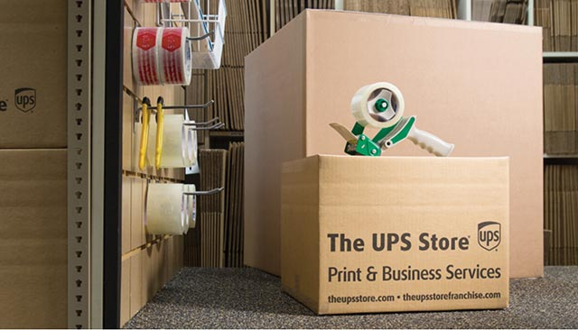 "Boxes and packing materials, with the words ""The UPS Store"" on the side"