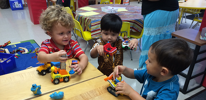 CDC- Children playing with toy cars in a classroom