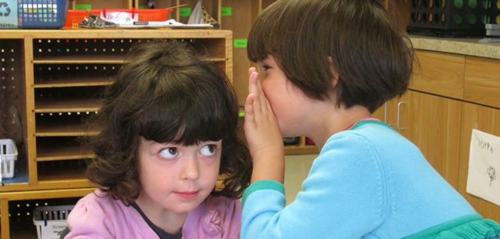 CDC children whispering in the classroom