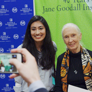 Jane Goodall poses for a picture with an AU student after delivering a lecture at the School of International Service.