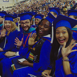 American University students wave for the camera at 2018 Commencement