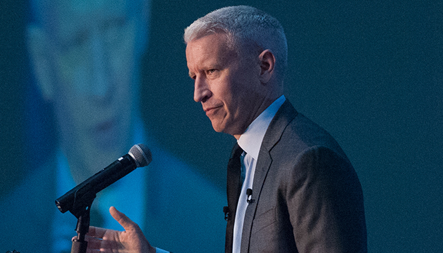 Anderson Cooper speaking at a podium
