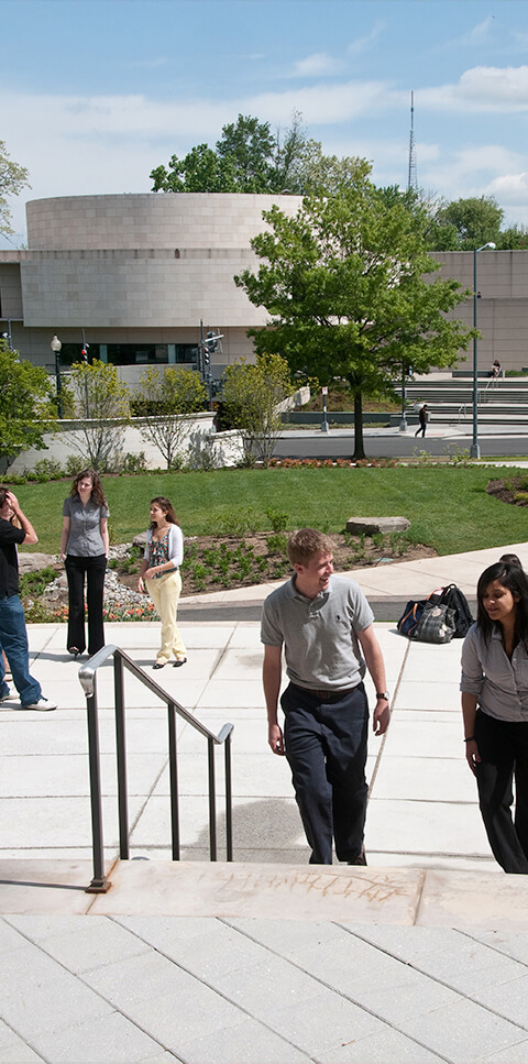 Students enter the Kogod building using the side terrace
