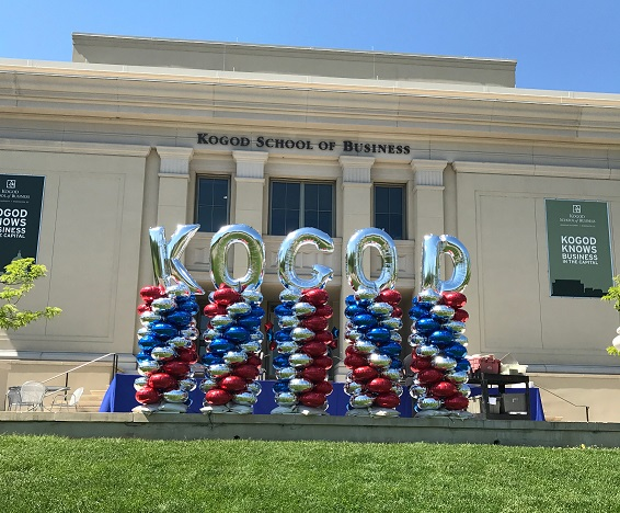 balloons spelling K, O, G, O, D in front of the Kogod building.