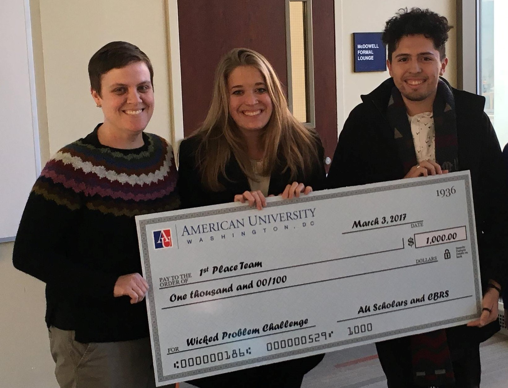 Wicked Problem challenge winners with prize check