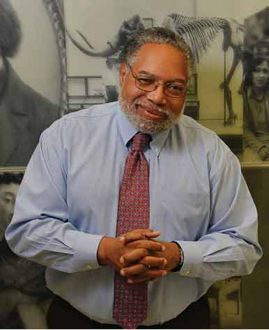 NMAAHC director Lonnie Bunch in front of a museum exhibit