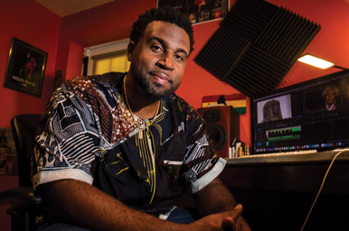 Darnley Hodge sits in his Oxon Hill, Maryland, editing bay