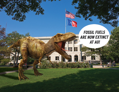dinosaur in front of Mary Graydon Center proclaiming that fossil fuels are extinct at AU