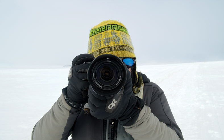 mike lucibella points his nikon at the camera in Antarctica