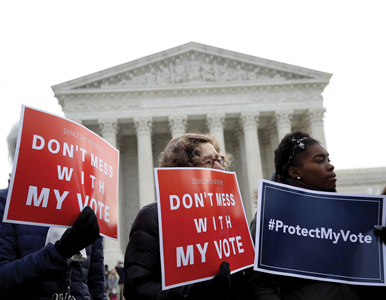 voting rights activists gather in front of the Supreme Court
