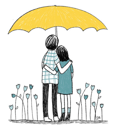 couple hugging under a yellow umbrella