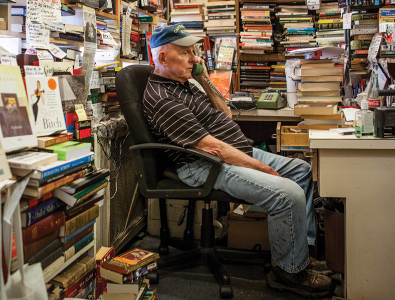 Jim Toole at the front desk at Capitol Hill Books