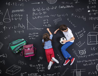 kids doing math problems on a chalkboard