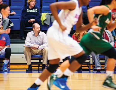 Writer Mike Unger on the bench of the AU women's basketball team