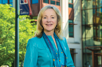 Sherry Lee Mueller in front of AU's School of International Service