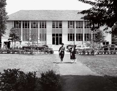 From the archives: three students walking in front of the School of International Service building.