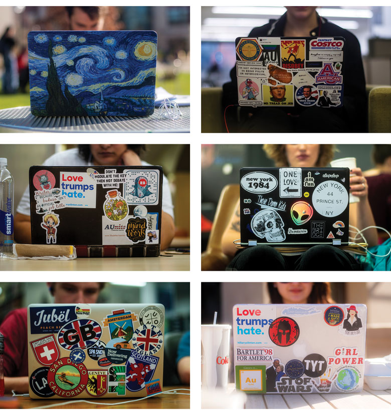 six laptops with an array of decorative stickers
