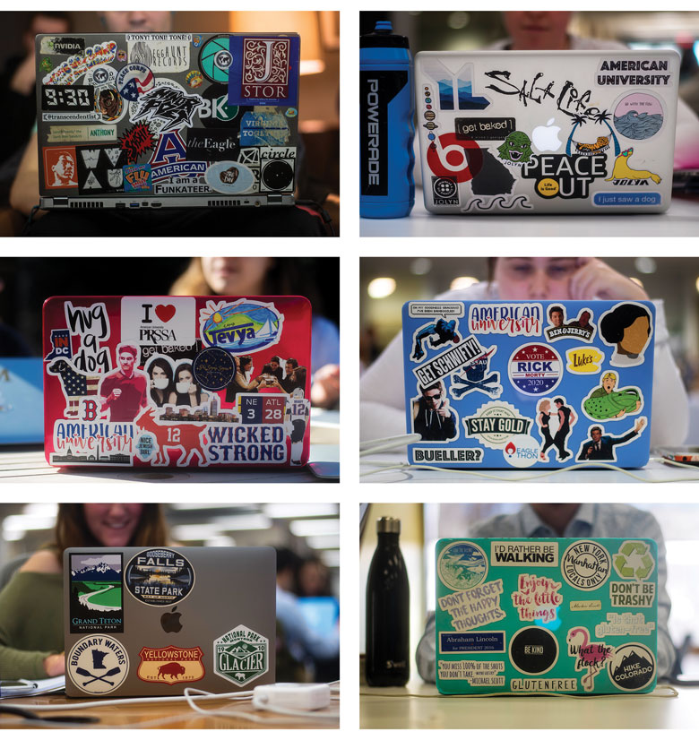 six laptops decorated with an array of colorful stickers