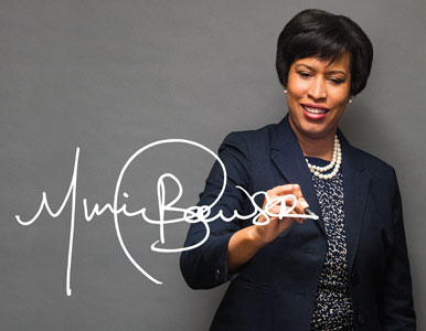 DC Mayor Muriel Bowser signing her name