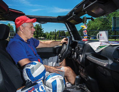 AU volletball coach Barry Goldberg sits behind the wheel of his Jeep