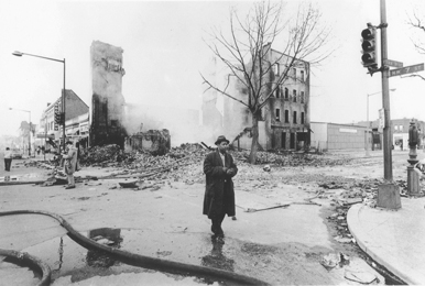 Man walks through devastated neighborhood after the 1968 riots