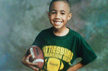Deon Jones as a little kid, holding a football