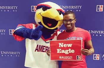 admitted student poses with Clawed the Eagle