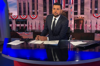 Ayman Mohyeldin behind the anchor desk at MSNBC