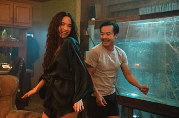 Trieu Tran dances near a fish tank as Sharko in Monsterland