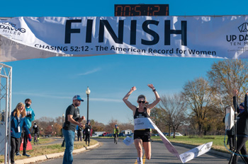 Keira D'Amato crosses the finish line of the Up Dawg Ten Miler in Anacostia Park