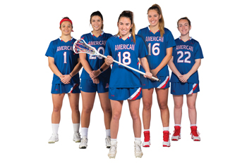 Kendall Goldblum holds a lacrosse stick and stands in front of four teammates