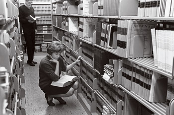 From the archives: a female student in the Washington College of Law library
