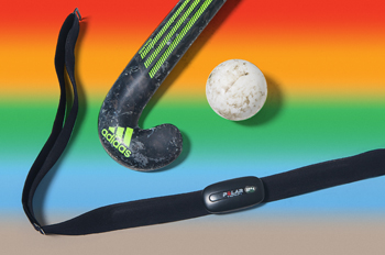 A field hockey stick, ball, and heart monitor